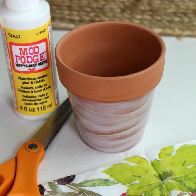 terra cotta pot painted with mod podge