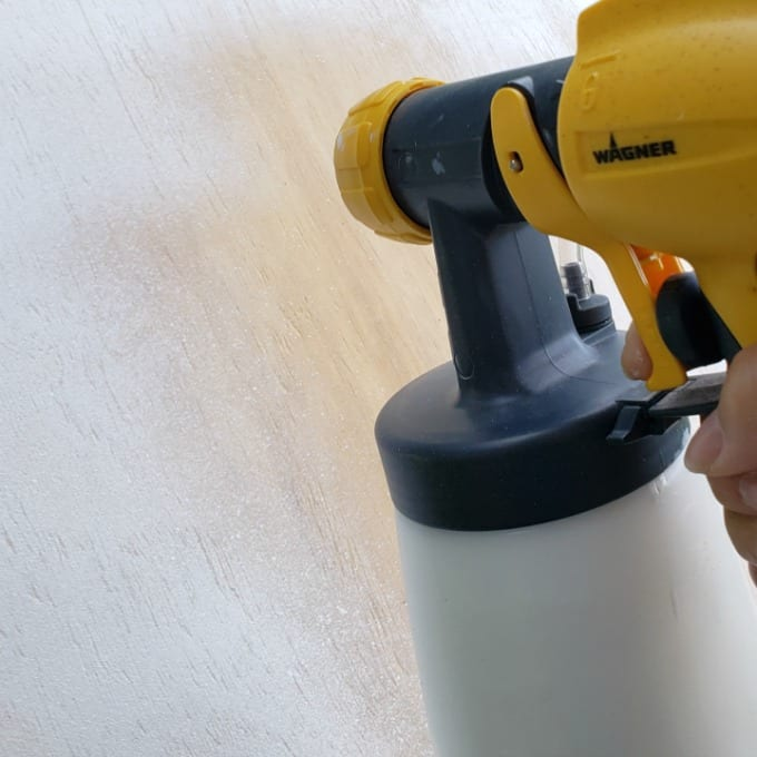 a Wagner SprayTech 4000 paint sprayer to paint plywood white.