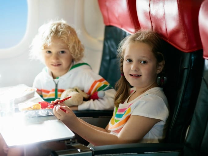 two children on a plane