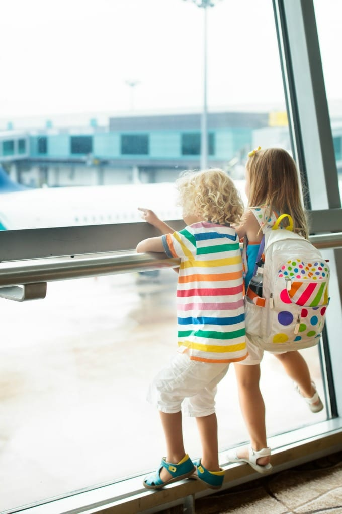 Tips for Flying with Kids - we have some tips and tricks for making traveling with children by air a little easier, including how to keep them entertained! via @jugglingactmama