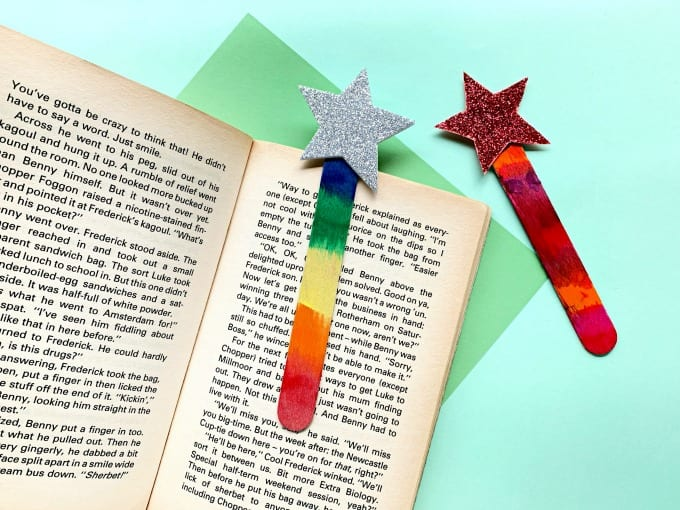 painted Craft Stick Star Bookmarks shown on a book