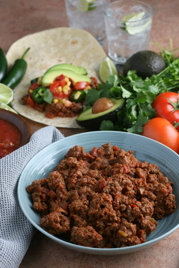 Ground beef taco meat: see how to cook taco meat in the Crockpot for make-ahead meals like tacos, burritos, enchiladas and more with this versatile recipe. via @jugglingactmama