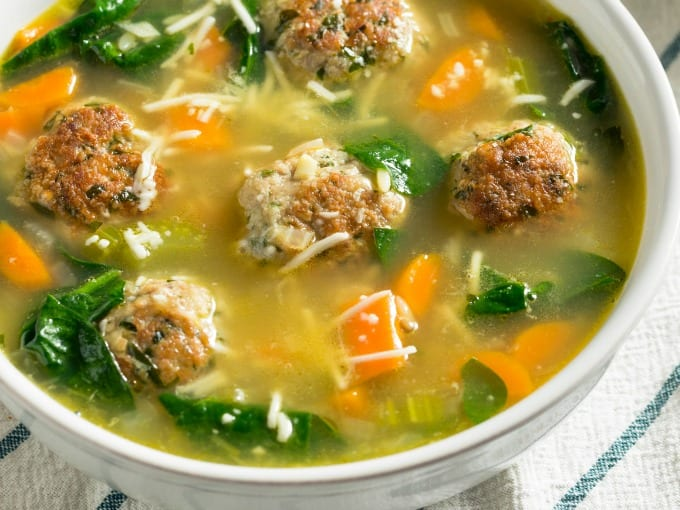 Close up of Slow Cooker Wedding Soup with Spinach and Meatballs