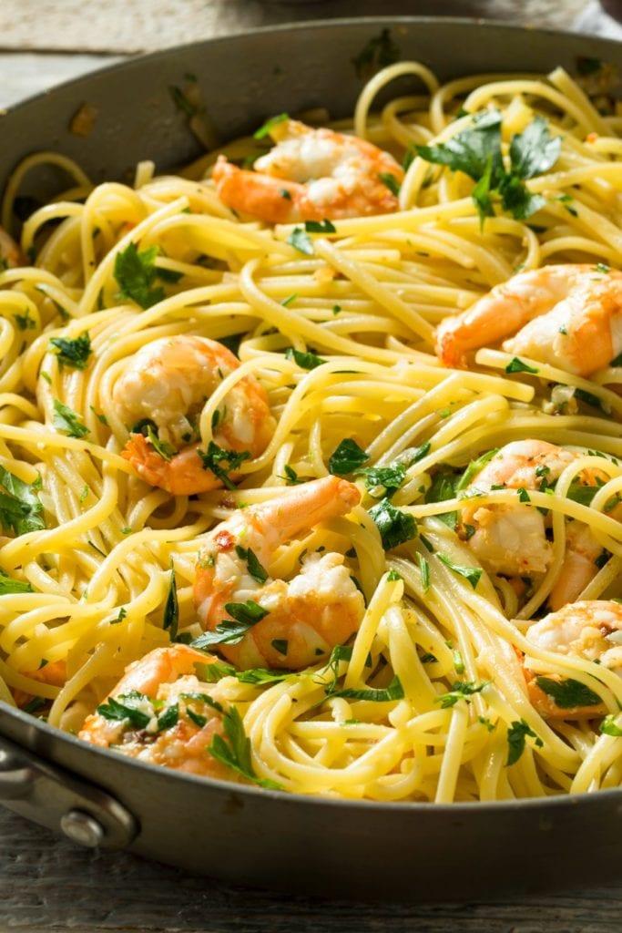 Lemon Garlic Shrimp Scampi in a skillet garnished with parsley