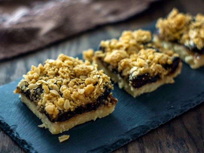 Close up of Homemade Oatmeal Fig Bars on a slate platter