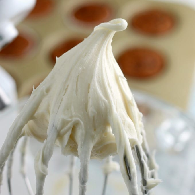 cream cheese frosting on a whisk attachment