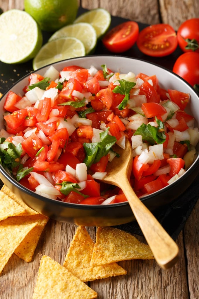 Fresh tomatoes, onions, cilantro, and lime come together to create the perfect classic topping for Mexican dishes like tacos or a dip to serve with tortilla chips. via @jugglingactmama