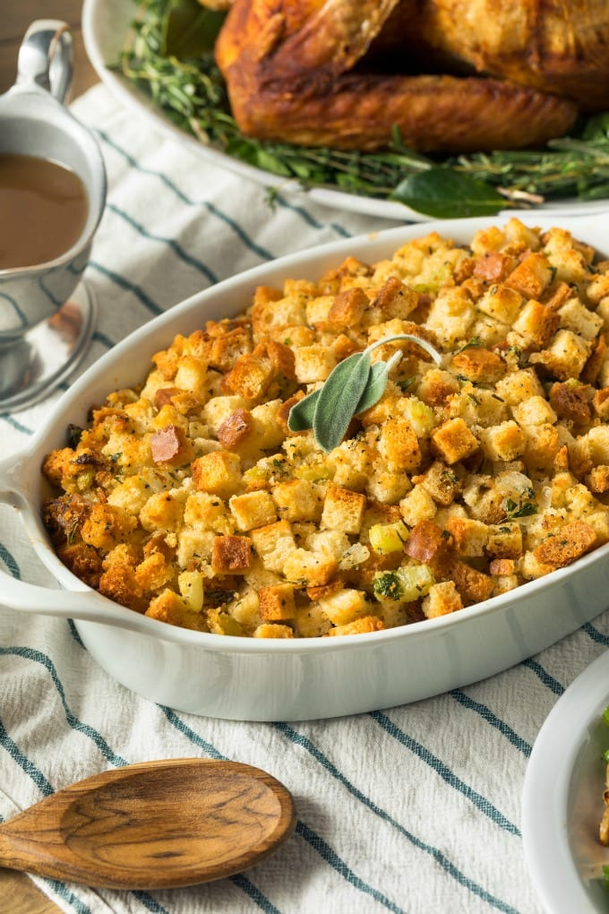 My go-to seasonal side is sausage cornbread stuffing recipe with finely diced onions, apples, and celery. Chopped apples add a little sweetness and pair beautifully with the sausage. Fresh rosemary and sage make the whole dish sing with Thanksgiving flavor! via @jugglingactmama
