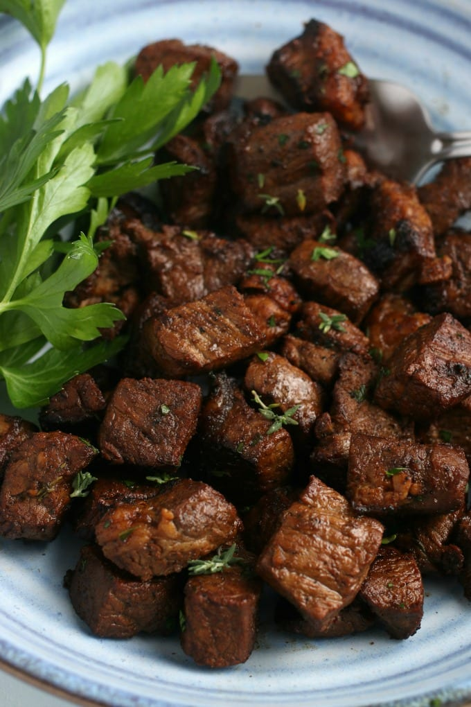 close up of Steak Bites with Garlic Butter garnished with parsley