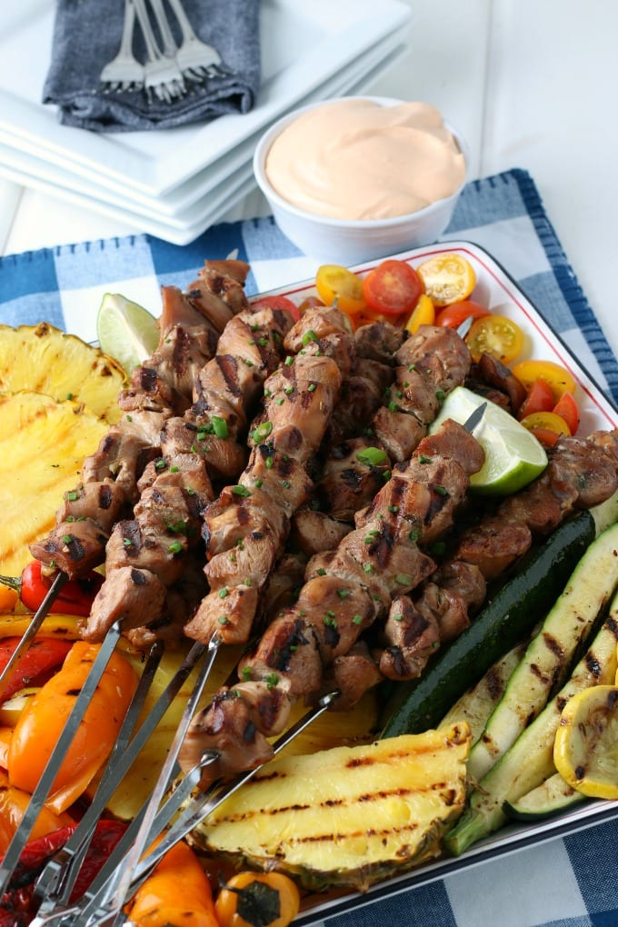 How Cook Chicken Kabobs on the Grill - grilled chicken kabobs with various grilled vegetables on a tray.