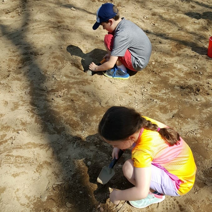children digging at America's Stonehenge in NH