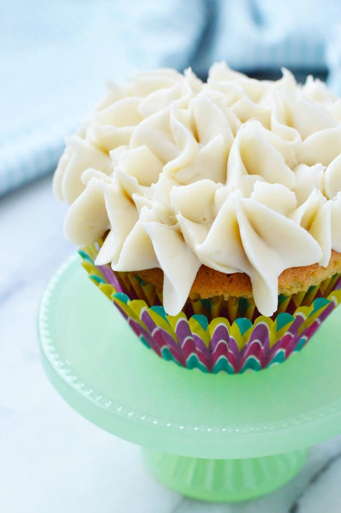 Easy vanilla cupcakes on a tiny cake stand.