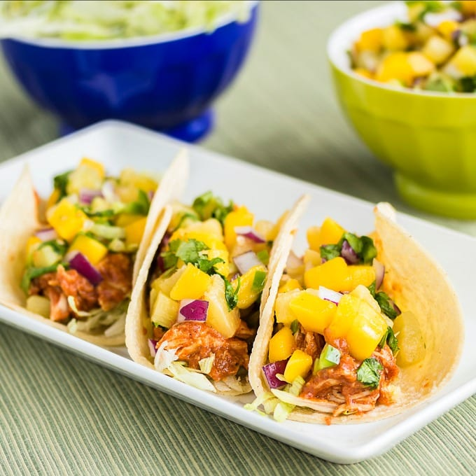 Close up image of BBQ Chicken Tacos on a white plate