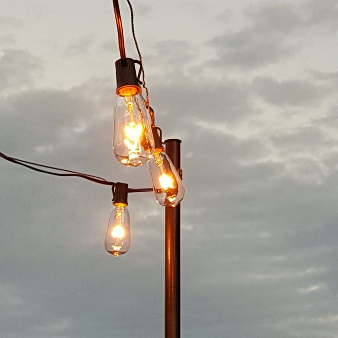 how to hang patio lights - string lights on a guidewire