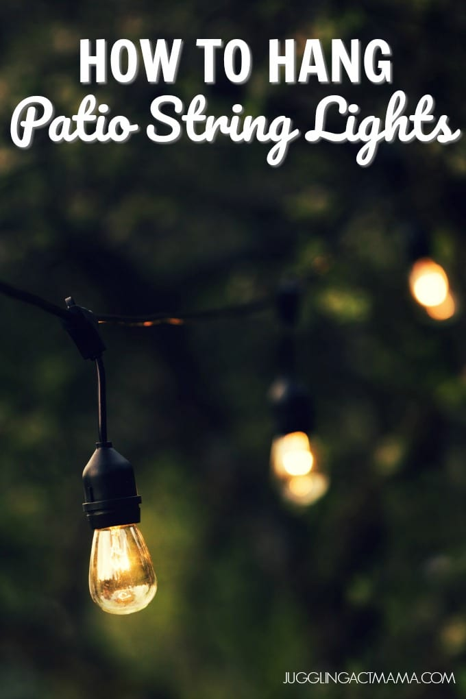How to Hang Patio Lights- outdoor string lights hanging in a backyard