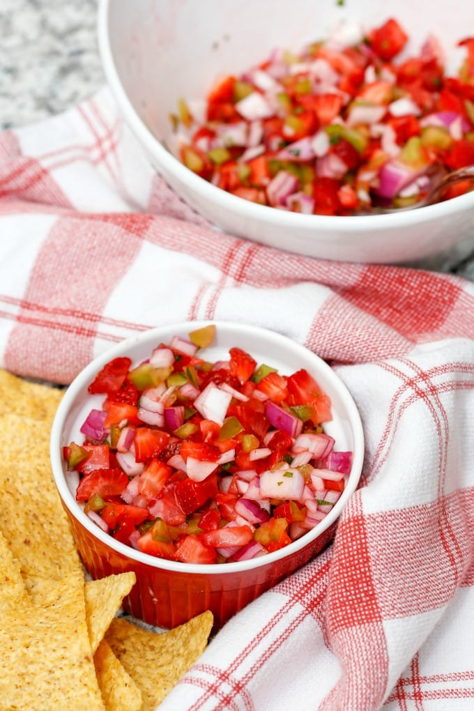 Strawberry Salsa is a fresh new take on a classic. Sweet with a little heat that can be adjusted easily to taste. You may never buy jar salsa again! via @jugglingactmama