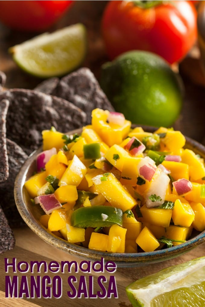 Homemade Mango Salsa is sweet yet a little spicy, and it's super easy to make! It's colorful and the perfect addition to any taco or as an appetizer with chips. via @jugglingactmama
