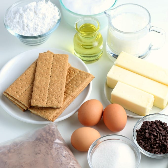 The basic ingredients for S'mores Cupcakes - graham crackers, eggs, chocolate cake mix, butter, chocolate chips, oil, milk, and sugar.
