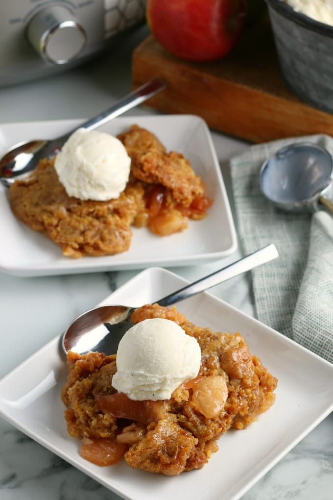 This slow cooker apple cobbler is a simple dessert that pleases a crowd. Pair the warm apple cobbler with vanilla ice cream and you've got a perfect Fall treat. via @jugglingactmama
