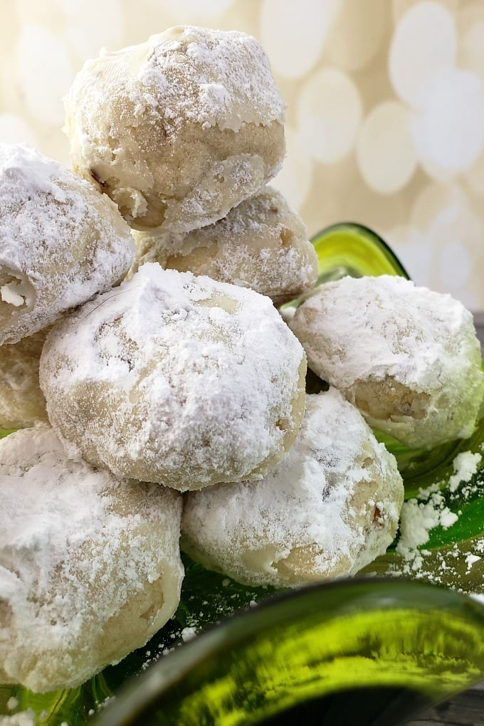 Russian Tea Cake Cookies, sometimes called Mexican Wedding Cookies or Christmas Snowball Cookies are nutty butter cookies rolled in powdered sugar - perfection! via @jugglingactmama