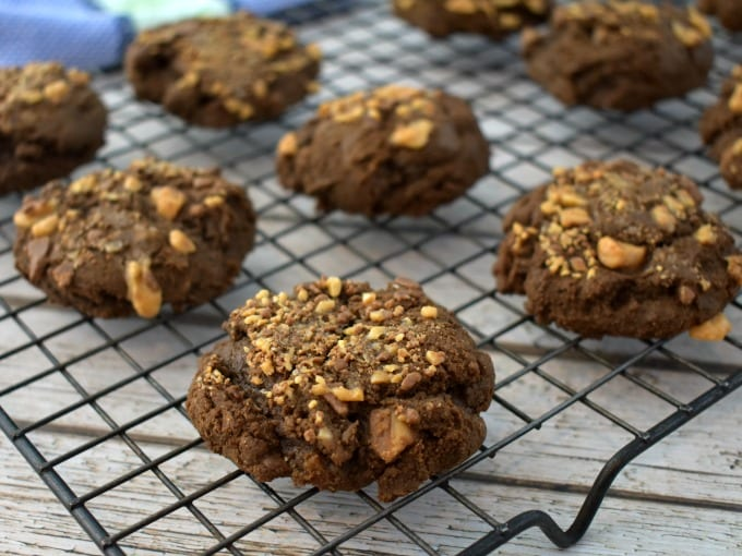 Double chocolate toffee cookies cooling on a cooling rack.