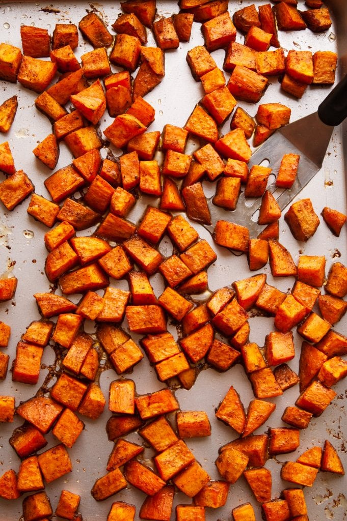 Roasted sweet potatoes on a baking sheet.