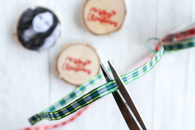 Close up of Christmas ribbon being cut by scissors.