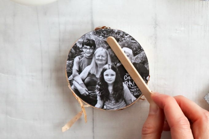 Instructions for creating this wood slice photo ornament craft using mod podge.
