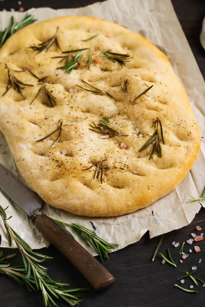 My Rosemary Focaccia Bread recipe is delicious as part of a sandwich or served with one of my favorite Mediterranean sheet pan meals. You will love it! via @jugglingactmama