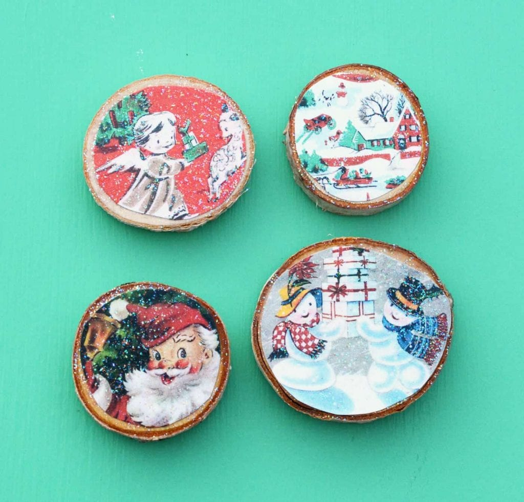 wood slices with vintage cards made into magnets