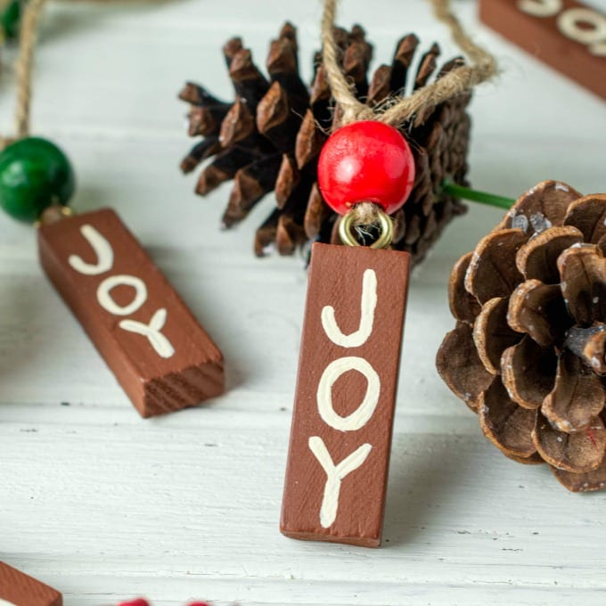 close up of Painted Wood Ornaments with the word JOY