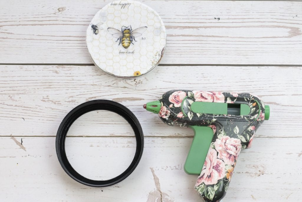 Mason Jar Lid Coasters DIY project: step by step instructions for making Mason Jar Lid Coasters with mason jar lids, paint, fabric, cork and a hot glue gun.