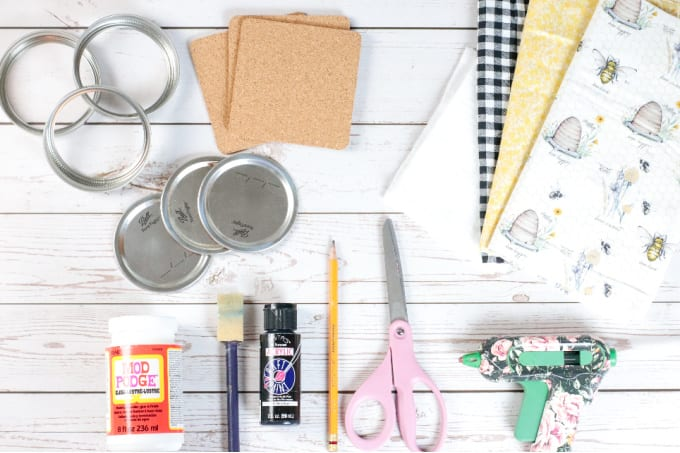 How to Make Mason Jar Lid Coasters - a top down close up image of all the supplies needed to make this DIY project.