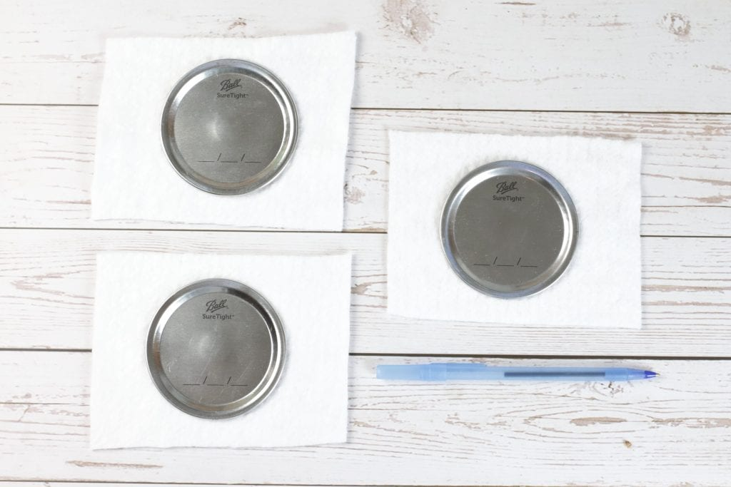 Mason Jar Lid Coasters DIY project with Insul-Brite for a Double-Sided Coffee Coaster: step by step instructions for making with mason jar lids, paint, fabric, and cork.