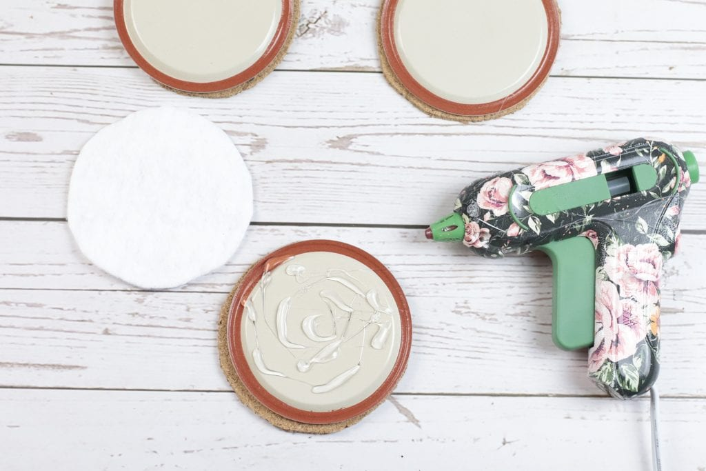 Mason Jar Lid Coasters DIY project with Insul-Brite for a Double-Sided Coffee Coaster: step by step instructions for making with mason jar lids, paint, fabric, cork and a glue gun.