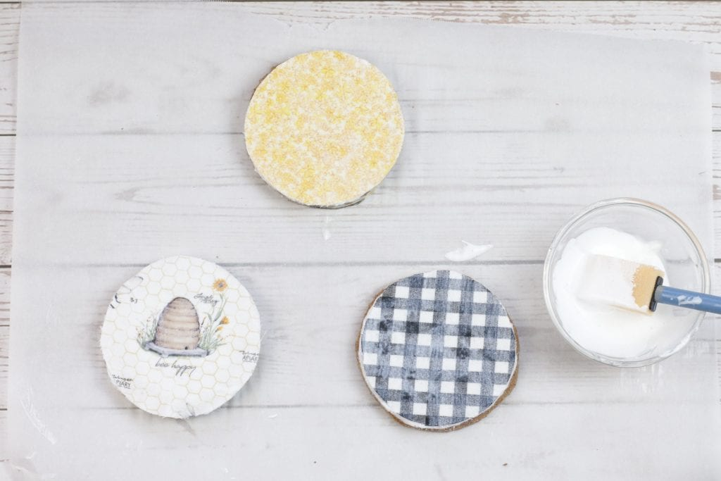 Mason Jar Lid Coasters DIY project with Insul-Brite for a Double-Sided Coffee Coaster: step by step instructions for making with mason jar lids, paint, fabric, cork and mod podge.