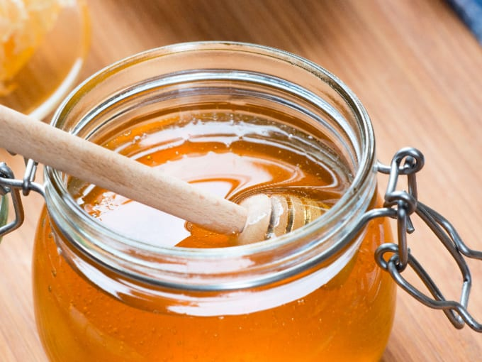 Honey can be used as a homemade rooting hormone - close up of a honey jar