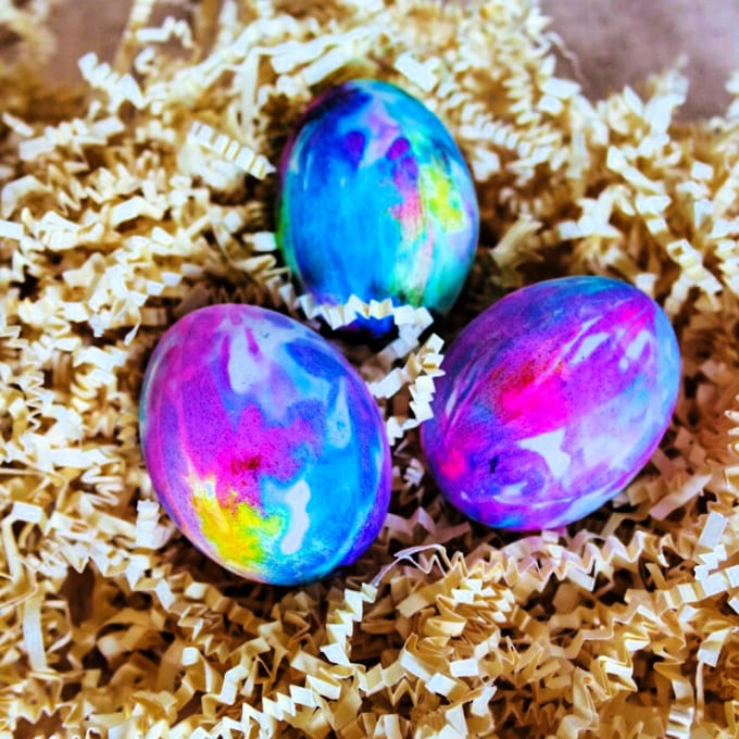 close up of three tie dyed Easter eggs
