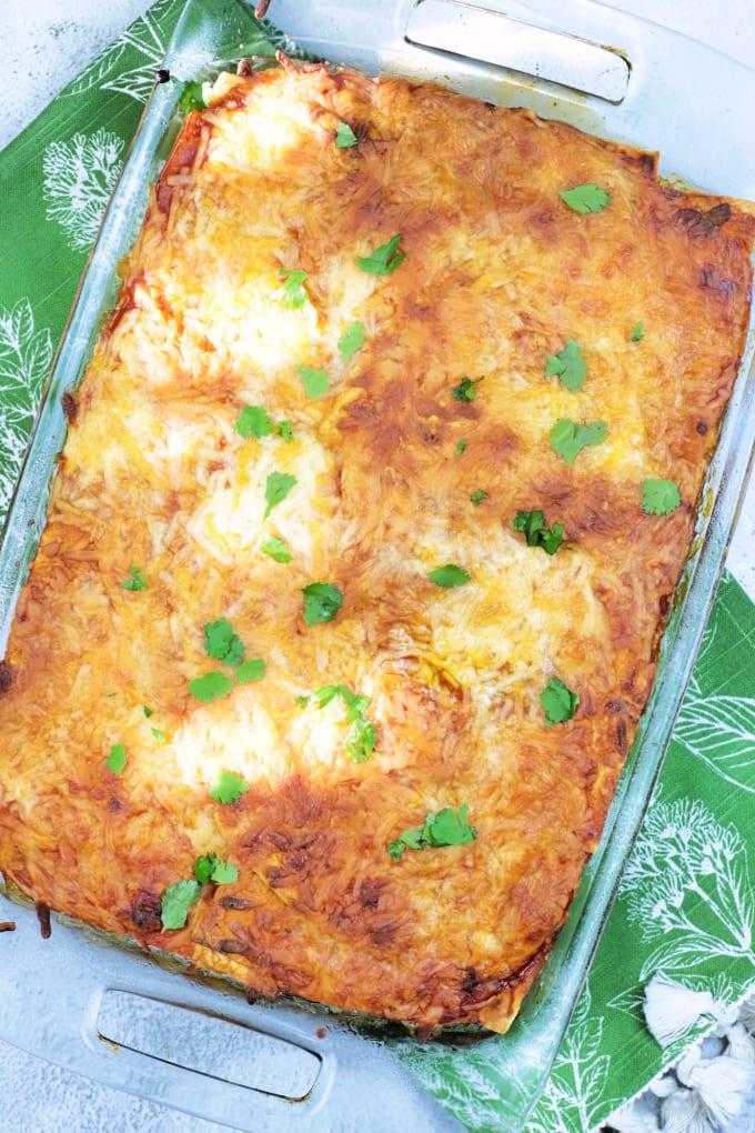 Breakfast enchilada casserole in a glass 9x13 baking dish