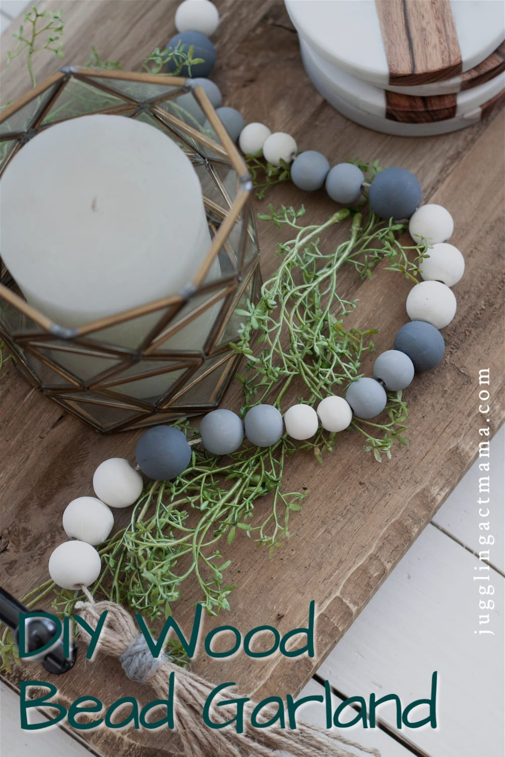This simple DIY Wood Bead Garland rivals what you might find at a home decor store, and will add farmhouse style to your home. via @jugglingactmama