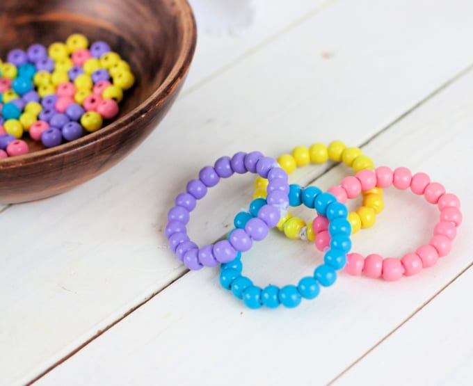 Napkin rings made of wood beads in a variety of colors.