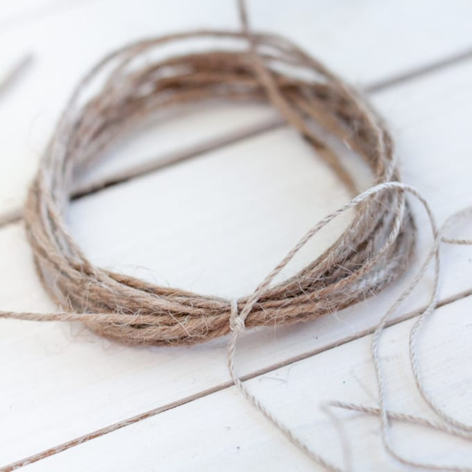 Jute twine being tied into tassels.