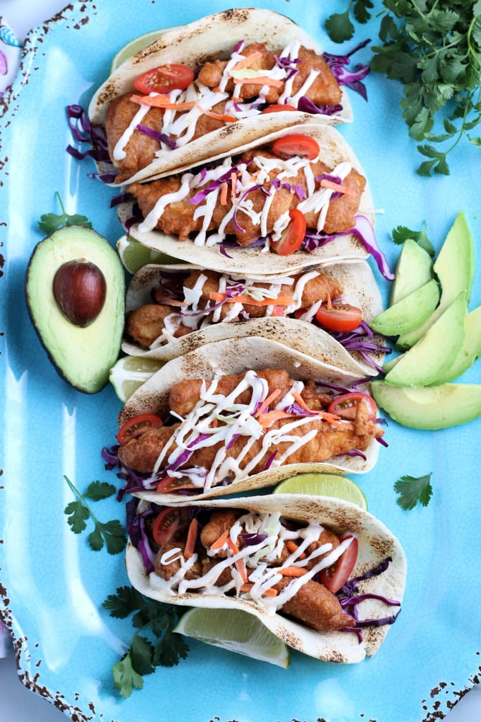 Baja tacos are a delicious twist on taco Tuesday. You will love the combination of fried fish and crisp slaw topped with a delicious sauce. Done in 15 minutes! via @jugglingactmama