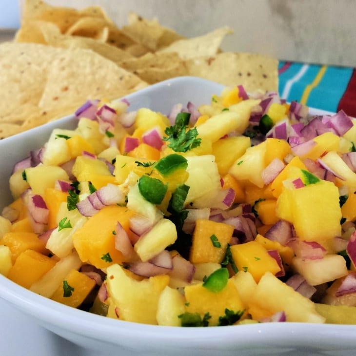Pineapple mango salsa in a white dish