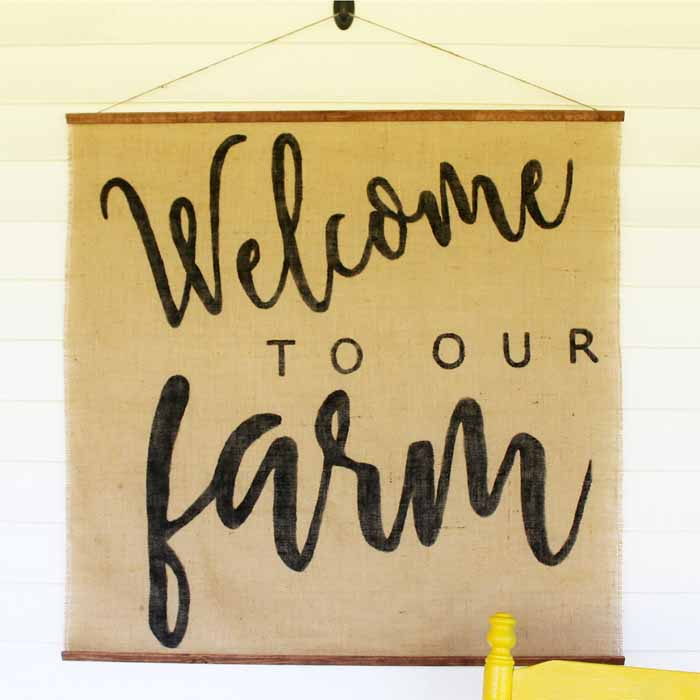 Close up image of a burlap sign that says Welcome to our Farm