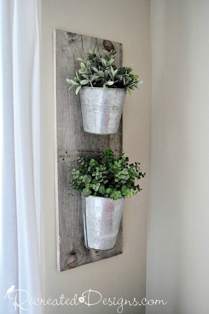 DIY Farmhouse style wall planter made from barn wood, galvanized buckets and greenery