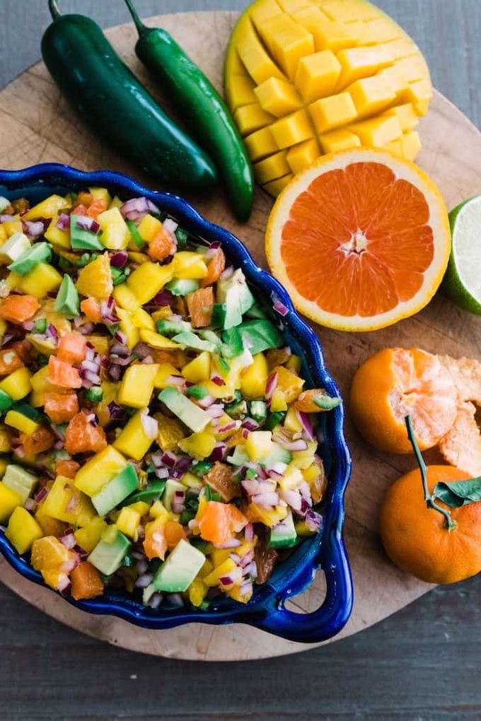 A round-up of deliciously fresh homemade salsa recipes. You'll enjoy the bounty of summer with these recipes filled with seasonal fruit and veggies. via @jugglingactmama