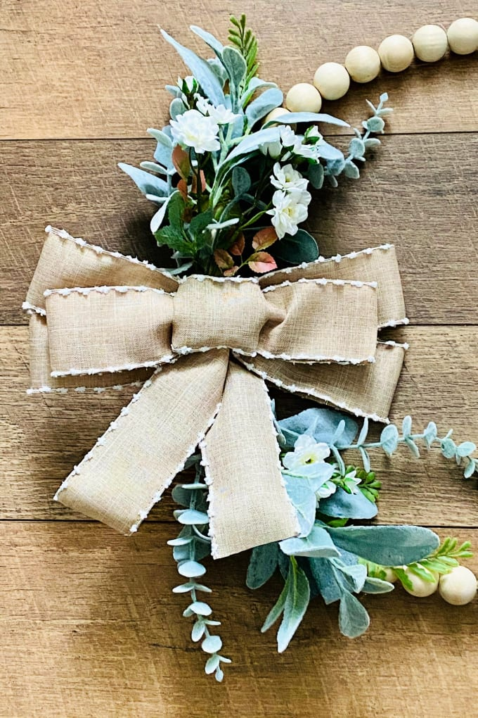 Learn to make your own gorgeous, farmhouse wood bead wreath. It's a simple and elegant way to add a farmhouse touch to your home!  via @jugglingactmama