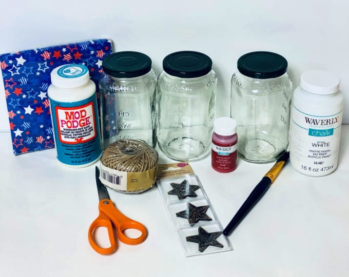 supplies for painting and decoupaging Mason Jars include scissors, Mod Podge and chalk paint.