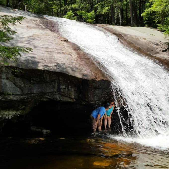 two people under Beede Falls